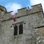 Stone in Oxney church tower with child's parachute